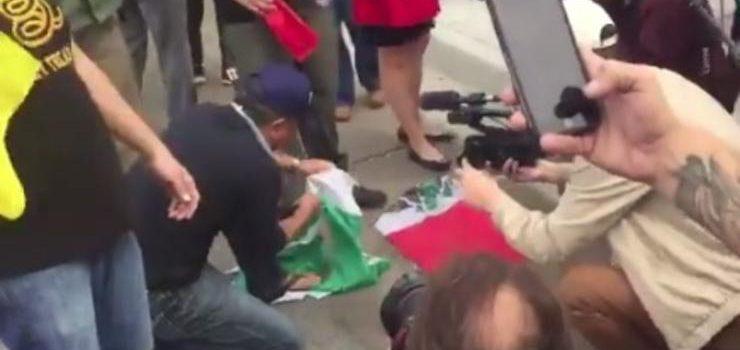 hombre rompe bandera de mexico